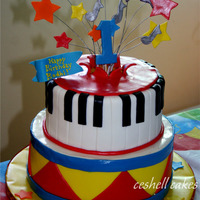 Child's Music Lover Birthday A 1-year-old's birthday cake. This was fun to make and much easier than I'd anticipated. If only the original idea were mine! The...