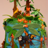 Rainforest Birthday Cake Red Velvet Cake, Cream Cheese Icing, Gum Paste Decorations