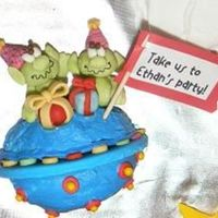 Take Us To Ethan's Party Gumpaste decorations on two cupcake tops for martian space ship