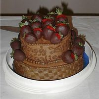 Chocolate Stawberries Cake This ia a tiered chocolate cake edged and topped with hand-dipped chocolate covered strawberries. Top tier was butter cake and bottom tier...