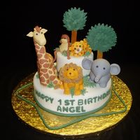 Safary  I saw a similar cake in a website and just had to try it. All the animals are made of gumpaste and fondant mixed. It was tough getting the...