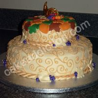 Thanksgiving Cake The cake is a pumpkin cake recipe with a pumpkin mousse filling and cream cheese buttercream frosting. I covered it in fondant. The...