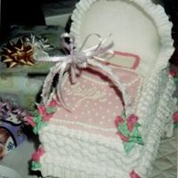 Baby Carriage A basketweave baby carriage with buttercream roses and decorated cookie wheels
