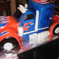 Optimus Prime Cake Optimus Prime cake made for my nephew's 7th birthday. He was ecstatic. He wouldnt let anybody eat the wheels because they were his....
