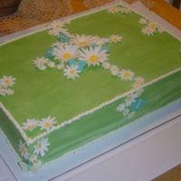 Picnic Daisies This was a labor day picnic cake. White and red velvet layers with almond BC filling and BC icing. Gumpaste diasies, and white chocolate...