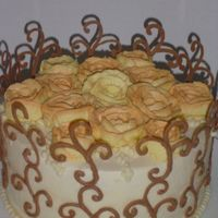 Swirly_Resized.jpg This was a birthday cake for a dear friend, Againg the picture does the cake no justice especially with the shadows cast by the chocolate...