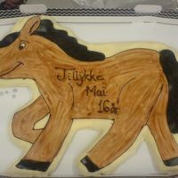 Horse Again danish pastry covered in marcipan. handpaintet with chocolat and colored in cacaopowder mixed with water
