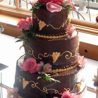 Heather's Wedding Cake This wedding reception was at a Winery, so the bride chose to have grapes designed on it. The cake is covered with chocolate bc and...