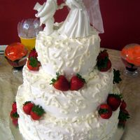 Strawberry Delight This cake was done for a bride who wanted EVERYTHING strawberry but on a limited budget. There were off white swirls on top of white BC...