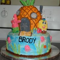 Spongebob Birthday I made this for my son's 7th birthday. All the details are fondant and the rest is butter cream. Pineapple is yellow cake and the...