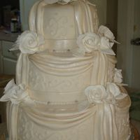 My 1St Wedding Cake A co worker wanted me to make her wedding cake. I was apprehensive, but it turned out okay