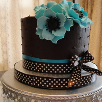 Ganache Frosting With Gumpaste Flowers. Chocolate cake with Ganache filling and frostine.Handmade gumpaste flowers.