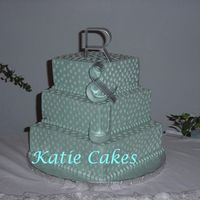 Blue Squares With Stars I had a hard time making this cake because I just don't like this color and then having to hand pipe a bazillion little stars on it....