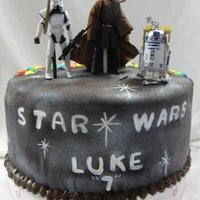 "Star Wars This is one side of a ""two sided"" cake I did for two of my grandchildren. Luke wanted Star Wars and Brooklyn wanted an M&M..."