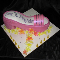 Pink Shoe Caramel mud cake carved into shoe shape, hand made frangipanis.