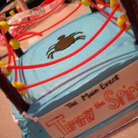 Wrestling Ring Cake 9x9 square pan, strawberry cake iced in buttercream. Chocolate covered pretzels for the posts, red licorice for the ropes, fastened to the...