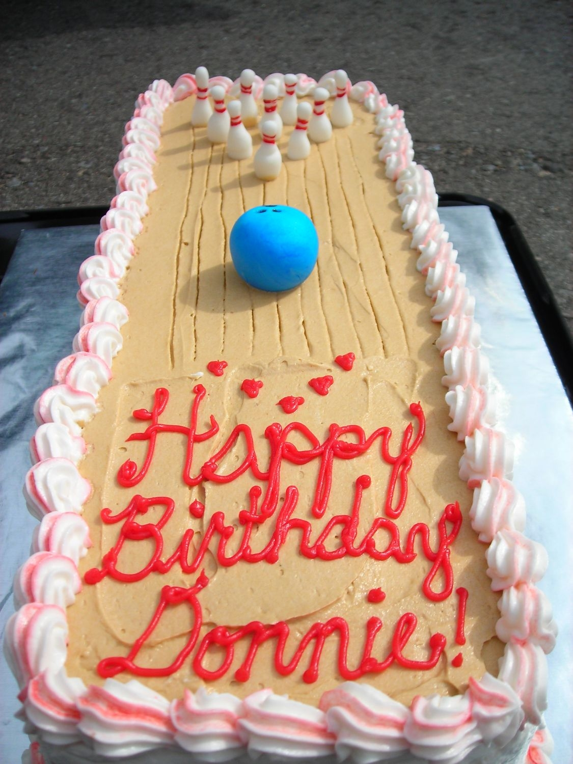 Bowling Lane Cake Originally wanted to put a fondant figure bowler on top, but he fell apart! Caramel cake, buttercream icing, fondant ball and pins