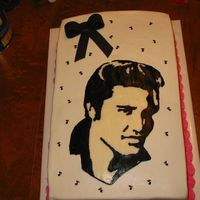Elvis Cake This is a work in progress. It has stars and a banner to go on. The stars are on wires and the banner goes across the bottom of elvis. I...