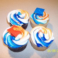 U Of I Graduation Cupcakes These are some graduation cupcakes I made for someone who was graduating from the university of illinois. Orange and blue themed with caps...