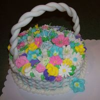 Easter Basket A basket cake I made for my family easter. Fondant handle and royal icing flowers.