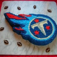 Tennessee Titans Groom's Cake This was my first sculpted cake. My DH did the initial pattern for me and I did the rest. Plain white cake and BC frosting. Suggestions,...