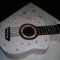 "Pink Guitar Cake Thanks to PB for help/inspiration for this one. Sculpted white cake with BC frosting, chocolate ""strings"", fondant flowers and..."