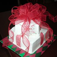 Christmas Present Cake This was SOO fun to make. Square cake kind of scared me though. But not anymore :-) Devil's food cake, BC frosting, fabric bow and...
