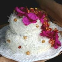 Laura And Rob's Engagement Luau Idea from Dede Wilson. This is her Tropical Passion Coconut Cake with Macadamias. I used flaked coconut instead of the sweetened shredded...