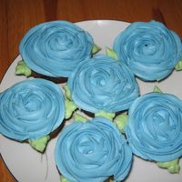Blue Rose Cupcakes I really liked the pink rose cupcakes jammjenks did, so I tried my hand at some blue ones. Mine are not as pretty as her's, but I love...