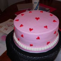 Pink With Red Heart Valentine's Day Cake French Vanilla Cake with Buttercream frosting and Strawberry Cream filling. It was awesome!! This is my 3rd cake. I used the paper towel to...