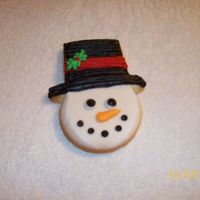 Snowman Sugar cookies decorated with Wilton's snow-white buttercream.