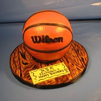 Basketball Cake For Wilson Birthday cake for a man who loves basketball and is named Wilson!Fondant covered cake board and cake.