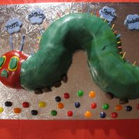 The Very Hungry Caterpillar I made this cake for my daughter's first birthday, it is her favorite book! It is a bundt cake cut into the shape of the caterpillar...