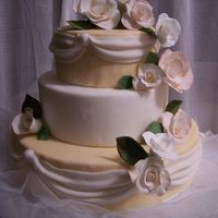 Wedding Rose Cascade Wedding cake for my sister's wedding. Roses made in gumpaste and cake covered in Fondant.