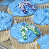 Jakes Pool Party Cupcakes White chocolate and milk chocolate cupcakes with a vanilla buttercream frosting. Waves and flipflops top these for his pool party. TFL!