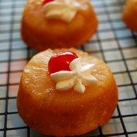 Mini Pineapple Upside-Down Cupcakes Yummy and so fun to make. Pineapple Coconut Cake with Pineapple ring and Brown Sugar Topping. Topped off with a Cherry and a Flowerette of...