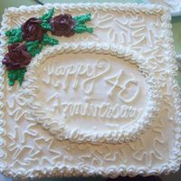 40Th Anniversary Cake Double Dark Chocolate Fudge cake filled and frosted with vanilla Almond Buttercream. Buttercream roses and cornelli lace decorations. The...