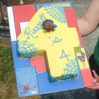 Russell's 4Th Birthday Cake Dark Chocolate Raspberry cake with Almond Vanilla Buttercream frosting. Carved as a 4...lol. Decorated in spider webs for a Spiderman Party...