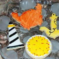 "Hand Painted Ocean Theme Set For Company Picnic Customer wanted ""anything oceany"" so I gave her lighthouses, crabs, anchors and suns. Sugar Cookies with Fondant, hand painted..."