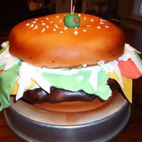 Big Burger!! This cake was fun to make. The buns are cake and the burger was rice krispies covered in fondant,