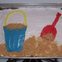 Shovel & Pail  I know- a cake decorated in pan. One of my very first that got decorated with more than just frosting & sprinkles. Graham crackers cut...