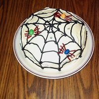 Spider Cake  Another of my first attempt at a decorated cake. Simple spiderweb design with spiders made out of peanut M&M's & licorice...
