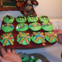 Ant, Caterpillar & Dragonfly Cupcakes Cupcakes for a bug-themed party. The ants are made from black or dark purple jelly beans & frosting legs. The caterpillars are fruit...