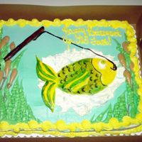 Gone Fishing Half sheet cake with buttercream icing and fondant work for the fish and fishing pole. I painted the fondant with color paste.