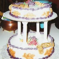 Fall Cake This was my first tiered cake. It was the final project in my Wilton class. It's iced and decorated with buttercream with purple,...