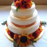 Harvest Flower Theme   Fondant and silk flower-covered, fall-color themed wedding cake