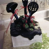 For Your Pampered Chef My mom was at a Pampered Chef party putting this cake together. She actually dipped the utensils in chocolate. As the hostess was...