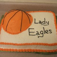 "Basketball Lady Eagles  Spice cake w/ cream cheese icing. I couldn't find my sports ball pan so I carved the basketball out of a 9"" round. Last minute..."