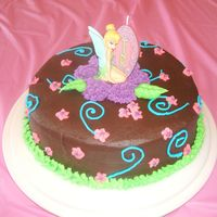 Tinkerbell Chocolate  Chocolate cake with chocolate chips and chocolate buttercream icing. Tinkerbell is a candle and other decorations are buttercream. Inspired...