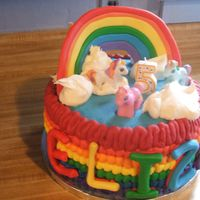 My Little Pony Rainbow  Cake all buttercream with fondant rainbow and lettering. Ponies were toys provided by client. I had a hard time getting the rainbow to...